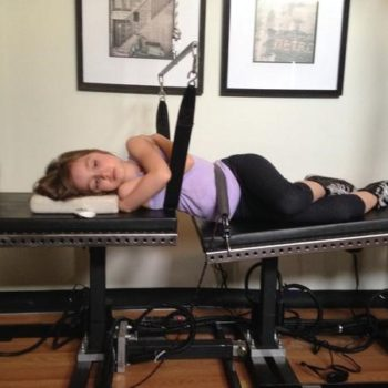 Girl in robo-trac decompression at greenville nc chiropractor